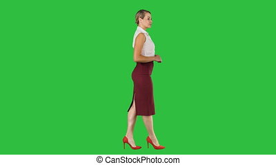 Walking business woman on a Green Screen, Chroma Key.