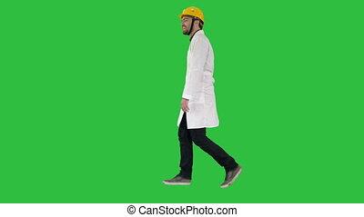 Walking engineer on a Green Screen, Chroma Key.