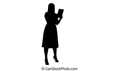 Silhouette Single girl making a video call on her tablet side view full lenth.