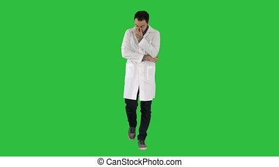 Tired doctor walking on a Green Screen, Chroma Key.
