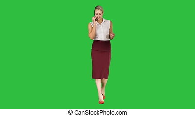 Young businesswoman worker talking on smartphone and smiling Business concept on a Green Screen, Chroma Key.