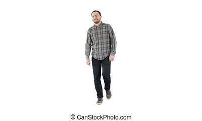 Young man walking in a good mood on white background.