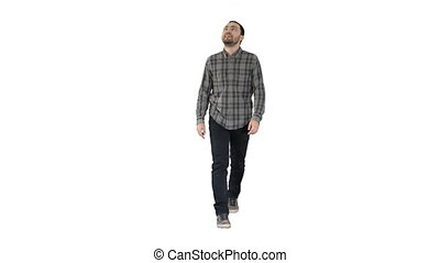 Young man walking looking up fascinated on white background....