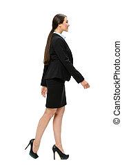 Full length profile of walking business woman