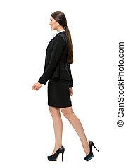 Full-length profile of walking business woman
