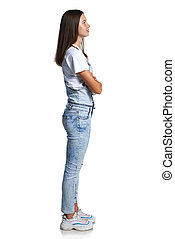 Full length profile portrait of a teen girl standing looking in front