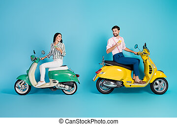 Full length profile side photo positive two people wife husband sit yellow motor bike use smartphone find adventure journey location wear formalwear shirt pants isolated blue color background