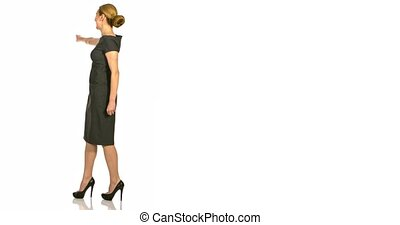 Full length rear view of business woman showing on something.