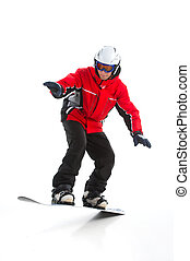 Full length shoot of Skillful male snowboarder jumping. ...