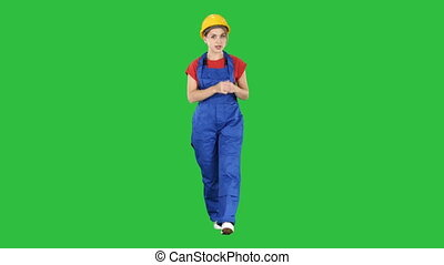 A woman construction worker talking to camera in confident way on a Green Screen, Chroma Key.