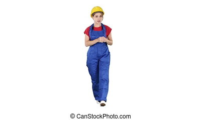 A woman construction worker talking to camera in confident way on white background.