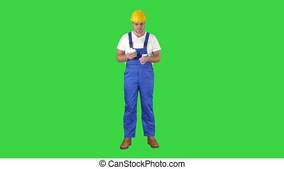 A workman excitedly counting his salary on a Green Screen,...