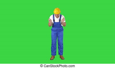 Architect construction worker sneeze on a Green Screen,...