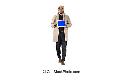 Attractive man holding tablet with blue key screen mockup on white background.