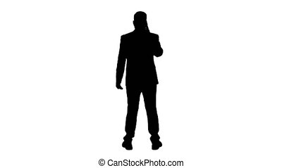 Silhouette Businessman with smartphone, making a phone call.