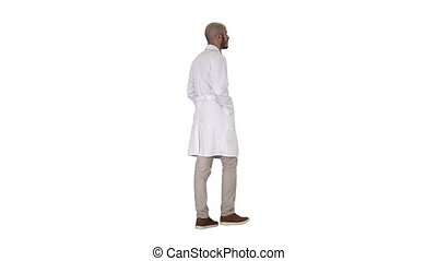 Full length shot. Back view. Walking doctor in a robe on white background. Professional shot in 4K resolution. 011. You can use it e.g. in your commercial video, business, presentation, broadcast
