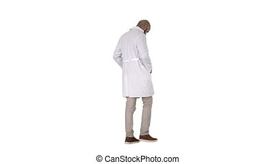 Full length shot. Back view. Walking doctor putting white robe on on white background. Professional shot in 4K resolution. 011. You can use it e.g. in your commercial video, business, presentation, broadcast