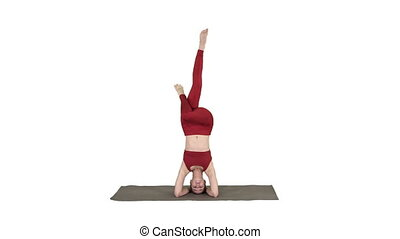 Beautiful young woman doing yoga exercise variation of...