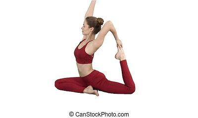 Beautiful young womandoing yoga or pilates exercise One Legged King Pigeon pose, Eka Pada Rajakapotasana on white background.