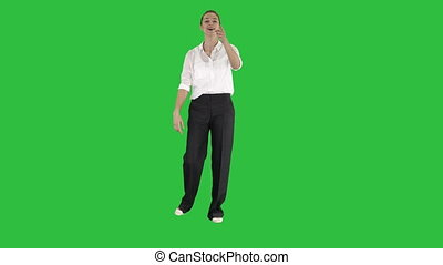Business woman laughing and saying something on a Green Screen, Chroma Key.