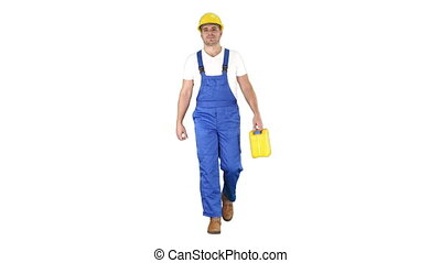 Full length shot. Construction worker in hard hat holding plastic canister and walking on white background. Professional shot in 4K resolution. 014. You can use it e.g. in your commercial video, business, presentation, broadcast