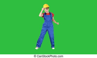 Female construction worker funny dance on a Green Screen, Chroma Key.