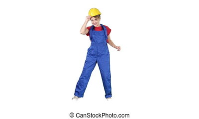 Female construction worker funny dance on white background.