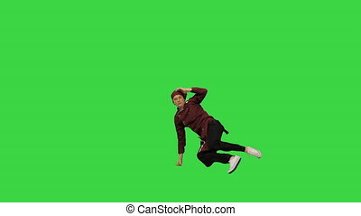 Full length shot. Front view. Male chef cook in red uniform break dancing against green background on a Green Screen, Chroma Key. Professional shot in 4K resolution. 045. You can use it e.g. in your medical, commercial video, business, presentation, broadcast