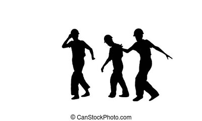 Full length shot. Front view. Silhouette Three male construction workers in hard hats hoping into the camera spot, break dancing and jumping away. Professional shot in 4K resolution. 045. You can use it e.g. in your medical, commercial video, business, presentation, broadcast