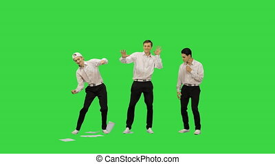 Three guys throwing documents in the air and starting to dance in a funny way on a Green Screen, Chroma Key.