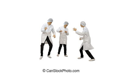 Full length shot. Front view. Three male doctors in white robes and protective caps doing funny celebration dance on white background. Professional shot in 4K resolution. 045. You can use it e.g. in your medical, commercial video, business, presentation, broadcast