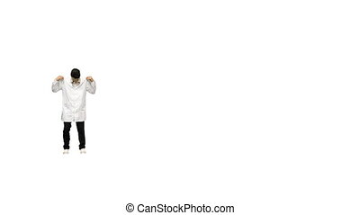 Full length shot. Front view. Young male doctor doing back flips, adjusts his robe looking at camera and then walks away on white background. Professional shot in 4K resolution. 045. You can use it e.g. in your medical, commercial video, business, presentation, broadcast