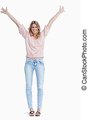 full length shot of a smiling woman with her arms raised up