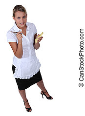 Full length shot of a waitress with an order pad