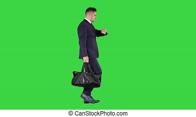 Busy man walking on street with briefcase on a Green Screen,...