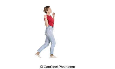 Happy smiling woman dancing and having fun on white background.