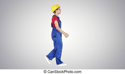 Happy woman construction worker walking in funny way willing...