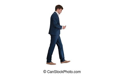 Full length shot. Side view. Satisfied businessman counting money and tucking it inside his jacket while walking on white background. Professional shot in 4K resolution. 047. You can use it e.g. in your medical, commercial video, business, presentation, broadcast