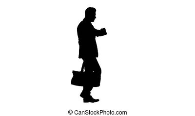 Silhouette Busy man walking on street with briefcase - Full...