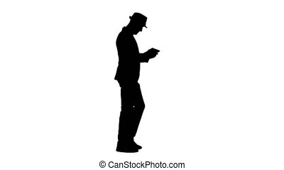 Silhouette Casual man using tablet and smiling while waking....