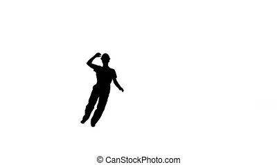 Full length shot. Side view. Silhouette Young construction worker in yellow hardhat doing hand spins looking at camera and walking away. Professional shot in 4K resolution. 045. You can use it e.g. in your medical, commercial video, business, presentation, broadcast