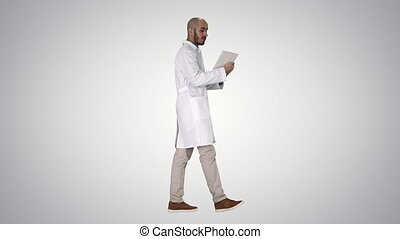 Sincere doctor making video call to his patient walking on...