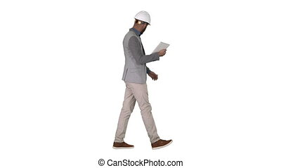 Full length shot. Side view. The hipster engineer making video call with tablet showing result of his work on white background. Professional shot in 4K resolution. 011. You can use it e.g. in your commercial video, business, presentation, broadcast