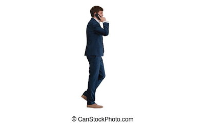 Young businessman talking on the phone while walking on white background.