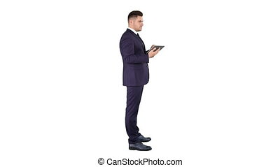 Young businessman touching digital tablet and checking object infront of him on white background.