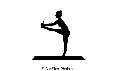 Silhouette Beautiful young fit woman in sportswear doing...