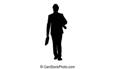 Silhouette Male architect in a suit and hard hat walking with blueprints and briefcase.