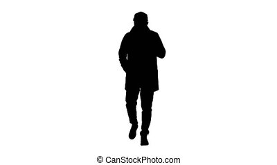 Silhouette Talking young man in trench coat confidently talking to camera. Just move forward.