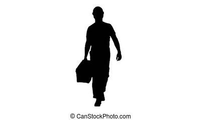 Full length shot. Silhouette Walking construction worker with toolbox. Professional shot in 4K resolution. 014. You can use it e.g. in your commercial video, business, presentation, broadcast