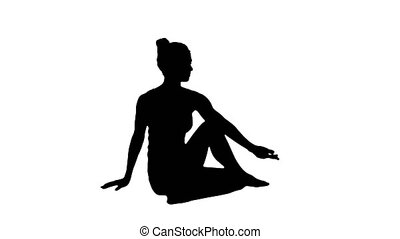 Silhouette Young beautiful woman doing yoga asana Marichyasana.
